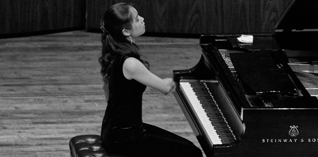 2015 Session 1 student performing in final Showcase Recital in Meany Hall at the University of Washington. ~ Seattle Piano Institute